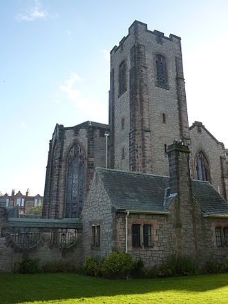 Reid Memorial Church - The tower to the south-east, with the cloister area below