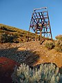 Relatively rare steel headframe and incline entrance (the 8' diameter pipe in the lower left) at the Delano Mine, Delano, Elko Co., NV - panoramio.jpg