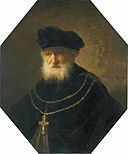 Rembrandt - Bust of an old bearded man wearing a golden chain with a cross.jpg