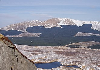 Galloway Hills - Looking north east over the Silver Flowe from Craignaw in the Dungeon hills with Corserine (just right of centre), and Carlin's Cairn (left of centre) on the Rhinns of Kells ridge - winter. The loch in the foreground is Long Loch of the Dungeon.