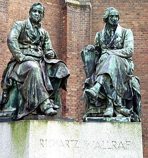 Museum für Angewandte Kunst (Cologne) - Statues of Johann Heinrich Richartz and Ferdinand Franz Wallraf in front of the museum (photomontage).
