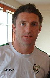 身着白色爱尔兰队服的罗比·基恩