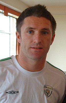 Robbie Keane in his white Ireland shirt