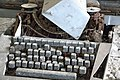 Rusty Optima typewriter front detail in an hungarian abandoned factory.jpg