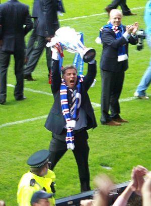 Ally McCoist - McCoist celebrating with the SPL trophy in 2009