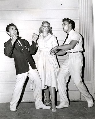 John Saxon - Saxon (right) with Sal Mineo and Sue George a publicity still for Rock, Pretty Baby (1956)