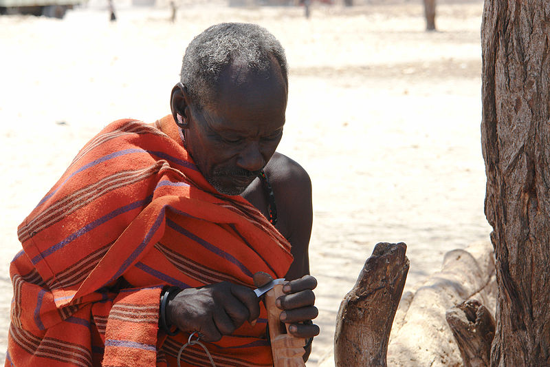 File:Samburu man carving wood.jpg