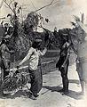 Sarawak; a Kayan woman dancing with the head of an enemy. Ph Wellcome V0037460.jpg