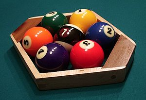 Nine-ball - Racking a seven-ball game with a special hex rack and black-striped 7 ball.