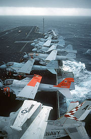 Several A-6 aircraft parked with EA-6 and S-3 aboard CV-67