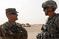Sgt. Maj. of the Army Raymond Chandler III (left), speaks with Col. Scott Efflandt, the commander of the 1st Brigade Combat Team, 1st Cavalry Division, during his visit to Camp Buehring, Kuwait, April 1, 2012 120401-A-AX263-053.jpg