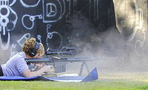 Hurlburt Field - U.S. Air Force MSgt Tanya Breed demonstrates a Barrett .50 caliber rifle during a special operations training course at Hurlburt Field.