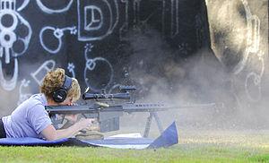 Hurlburt Field - U.S. Air Force MSgt Tanya Breed demonstrates a Barrett .50 caliber rifle during a special operations training course at Hurlburt Field.