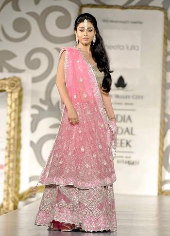 English: Indian actress Shriya Saran walks the...