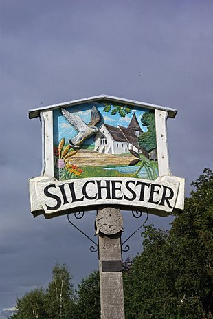The village sign in front of Silchester Village Hall