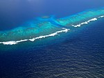 Small pass in the barrier reef of Ha'apai (Tonga).jpg
