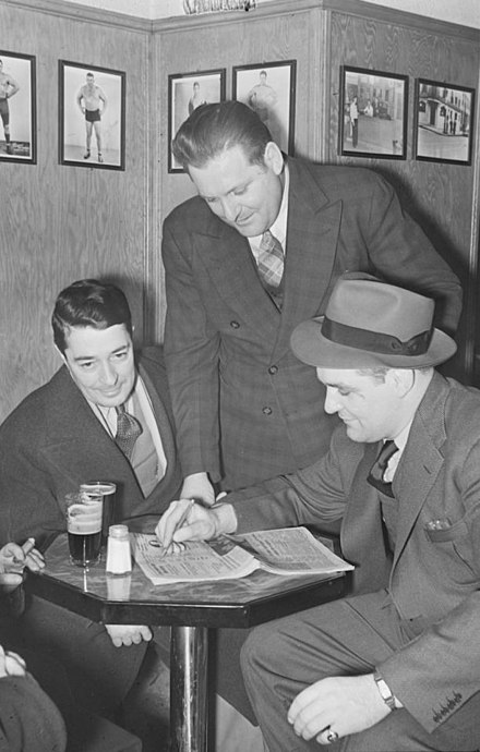 At his tavern in Montreal in 1940 with pictures of wrestlers on the wall Snapshots. Taverne Yvon Robert. St. Gabriel & St. Jacques BAnQ P48S1P05750.jpg