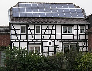 Timber framed house with a photovoltaic array ...
