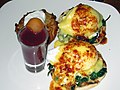Spinach and goat's cheese eggs benedict with potato tartlet and a blueberry smoothie shot (3292893847).jpg