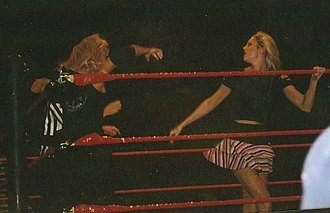 Stacy Keibler - Keibler wrestling Trish Stratus during a house show in October 2004