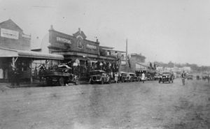 StateLibQld 1 187603 Street in Beaudesert decorated for the visit by the Duke and Duchess of York, 1927.jpg