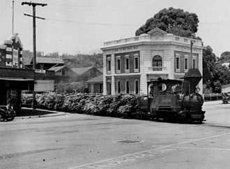 Rail transport in Queensland - Sugar cane train travelling along Currie Street, Nambour, ca. 1939