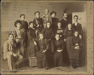 James Nairn - Group portrait of students at the Wellington School of Design. James Nairn and Mabel Hill at far left. Woman posing with skeleton's arm around her shoulder is Mary Elizabeth Tripe.