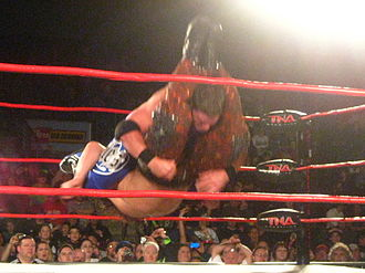 Facebuster - Styles performing the Styles Clash on Matt Hardy.