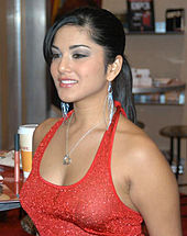 A black-haired woman wearing a red dress.