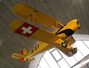 Swiss Air Force Bücker Bü 131 seen from below.jpg