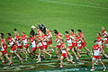 Sydney Swans players warming up.jpg