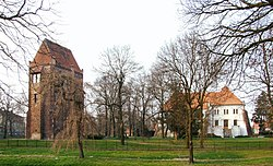 Szamotuły Castle seen from a park