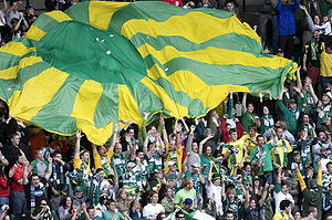 Timbers Army - The Timbers Army in 2009 performing a common tifo after a goal.