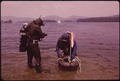 TWO SCUBA DIVERS FROM A NEW YORK CITY CLUB READY THEIR SAFETY TUBE WITH FLAG WHICH FLOATS ABOVE THEIR DIVING AREA TO... - NARA - 554614.tif