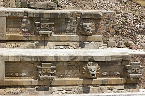 "Temple of the Feathered Serpent, Teotihuacan - Detail of the pyramid, showing the alternating ""Tlaloc"" (left) and feathered serpent (right) heads. Note the long undulating feathered serpents in profile under the heads."