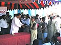 The Minister for Youth Affairs and Sports Shri Sunil Dutt distributing relief items to Tsunami victims at a relief camp in Chennai, on January 6, 2005.jpg