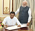The President of the Democratic Socialist Republic of Sri Lanka, Mr. Maithripala Sirisena signing the visitor's book, at Hyderabad House, in New Delhi on May 13, 2016. The Prime Minister, Shri Narendra Modi is also seen.jpg