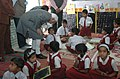 The Vice President, Shri Mohd. Hamid Ansari interacting with children during his visit to Anganwadi Centre and School, in Madhya Pradesh on February 11, 2010.jpg