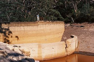 Peat Island -  The two walls of the Cascade Creek dam that supplied water for Peat and Milson Island. Photographed in 1991.
