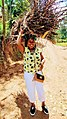 This is how Rwandese carry cooking woods.jpg