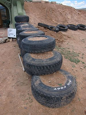 Earthship - Tires rammed with earth and stacked