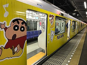 Crayon Shin-chan - Train in special Crayon Shin-chan vinyl wrapping livery at Kurihashi Station, Japan