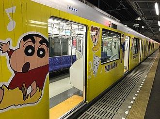 Crayon Shin-chan - Train in special Crayon Shin-chan vinyl wrapping livery at Kurihashi Station, Japan