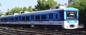 Domingo Faustino Sarmiento Railway - An electric train of urban services in TBA livery prior to re-nationalisation and renewal of the rolling stock.