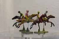 Toy steeplechase jockeys (24341683884).jpg
