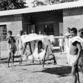 Transporting patient on litter, India, 1962 (16306854594).jpg