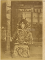 Two Actors of the Chinese Theater Depicting a Scene in which the Emperor is Attired in the Costume of the Han Dynasty, with a Figure of the Celestial Sovereign over Him. Beijing, 1874 WDL1943.png