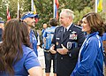 U.S. Air Force Gen. Mark A. Welsh III, second from right, the chief of staff of the Air Force, and his wife, Betty, right, speak to staff members with the Air Force Wounded Warrior program during the 2014 140928-F-SS904-042.jpg