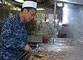 U.S. Navy Airman Catherine Burgess grills pork chops in the chief's mess aboard the aircraft carrier USS Nimitz (CVN 68) 130110-N-TR165-009.jpg