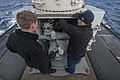 U.S. Navy Fire Controlman 2nd Class Carl Wagner, left, and Fire Controlman 2nd Class Christopher Ashmore conduct systems checks on a Mark 15 Phalanx close-in weapons system aboard the guided missile destroyer 131212-N-VC236-016.jpg